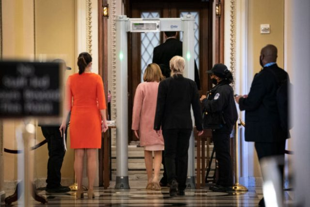 WASHINGTON, DC - JANUARY 21: Speaker of the House Nancy Pelosi (D-CA) walks through a metal detector before entering the House Chamber at the U.S. Capitol on January 21, 2021 in Washington, DC. Following the storming of the U.S. Capitol of January 6, the House is scheduled to vote Thursday afternoon on a rule change mandating fines for members who refuse to follow new security screening protocols for the House Chamber. (Photo by Drew Angerer/Getty Images)