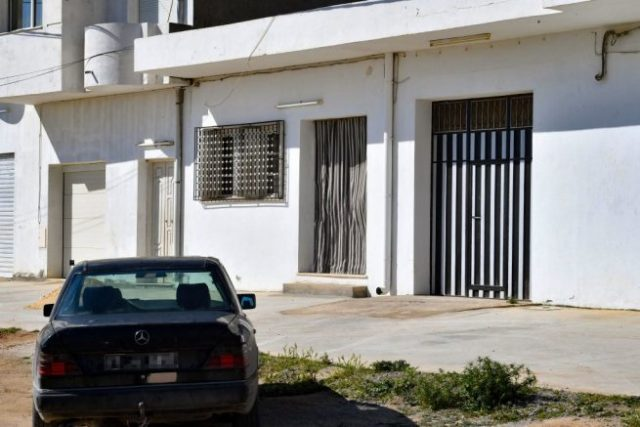 This picture taken on April 24, 2021, shows the entrance to the family home in the northeastern Tunisian town of M'saken, of a 36-year-old Tunisian man identified as Jamel Gorchene, who stabbed to death a French police employee at her workplace southwest of the French capital Paris yesterday, in a suspected Islamist attack. - The murder at a police station in Rambouillet, a commuter town about 60 kilometres (40 miles) from Paris, revived the trauma of a spate of deadly attacks last year.<br /> The victim was a 49-year-old woman named as Stephanie, a police administrative assistant and mother-of-two, who was stabbed twice in the throat at the entrance of the station. Her attacker was shot dead. (Photo by FETHI BELAID / AFP) (Photo by FETHI BELAID/AFP via Getty Images)