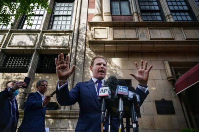 Andrew Giuliani, son of Donald Trump's former personal lawyer Rudy Giuliani, speaks to the press outside his father's apartment building in New York on April 28, 2021. - Federal investigators raided Rudy Giuliani's apartment early on April 28, as part of a probe into his dealings in Ukraine, US media reported. (Photo by Ed JONES / AFP) (Photo by ED JONES/AFP via Getty Images)