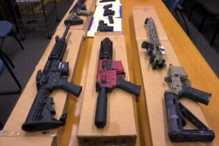 """FILE - This Nov. 27, 2019, file photo shows """"ghost guns"""" on display at the headquarters of the San Francisco Police Department in San Francisco. A proposal to ban build-your-own weapons known as """"ghost guns"""" is sparking passionate for-and-against arguments in the Nevada Legislature, just over three years after Las Vegas experienced the deadliest mass shooting in modern U.S. history. The bill introduced on Monday, March 15, 2021, would outlaw the possession and sale of homemade firearms. (AP Photo/Haven Daley, File)"""