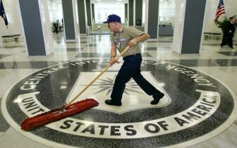 In this March 3, 2005, file photo a workman quickly slides a dust mop over the floor at the Central Intelligence Agency headquarters in Langley, Va., near Washington. (photo credit: AP/J. Scott Applewhite, File)