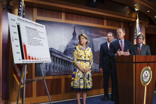 From left, Sen. Shelley Moore Capito, R-W.Va., the GOP's lead negotiator on a counteroffer to President Joe Biden's infrastructure plan, is joined by Sen. John Barrasso, R-Wyo., chairman of the Senate Republican Conference, Sen. Pat Toomey, R-Pa., and Sen. Roy Blunt, R-Mo., during a news conference at the Capitol in Washington, Thursday, May 27, 2021. (AP Photo/J. Scott Applewhite)