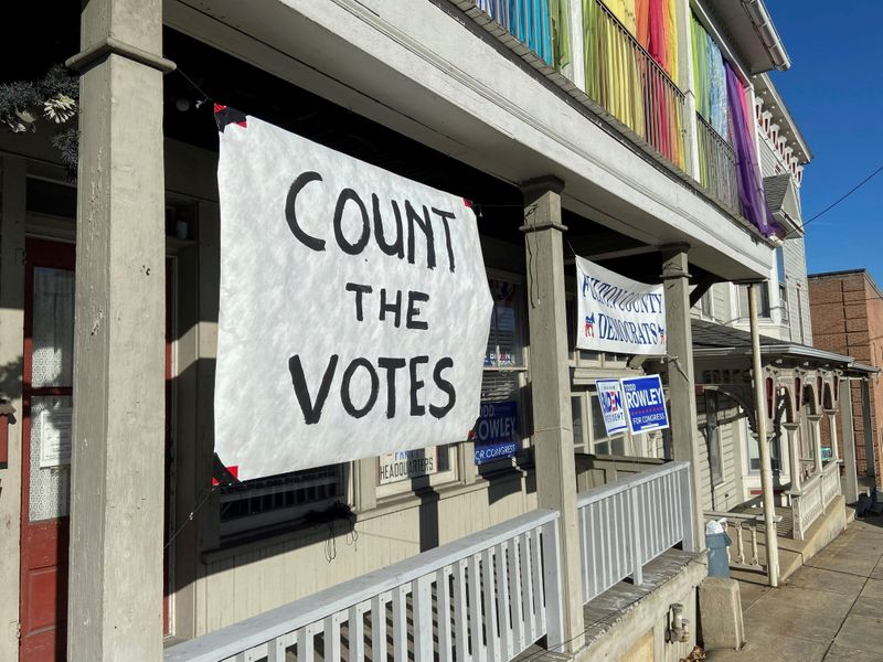 FILE PHOTO: A sign urging people to vote is seen on the porch of the Democratic Party's Fulton County headquarters on Election Day in McConnellsburg, Pennsylvania