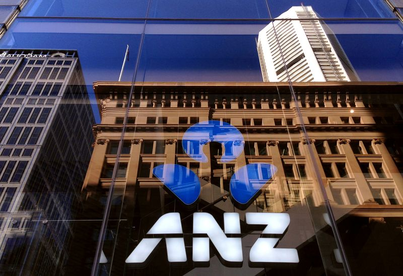 FILE PHOTO: The logo of the ANZ Banking Group is displayed in the window of a branch in central Sydney, Australia