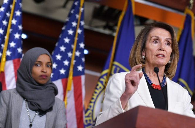 House Minority Leader Nancy Pelosi speaks during a press conference in the House Visitors Center at the US Capitol in Washington, DC on November 30, 2018. - At left is representative-elect Ilhan Omar, D-MN. (Photo by MANDEL NGAN / AFP) (Photo credit should read MANDEL NGAN/AFP via Getty Images)