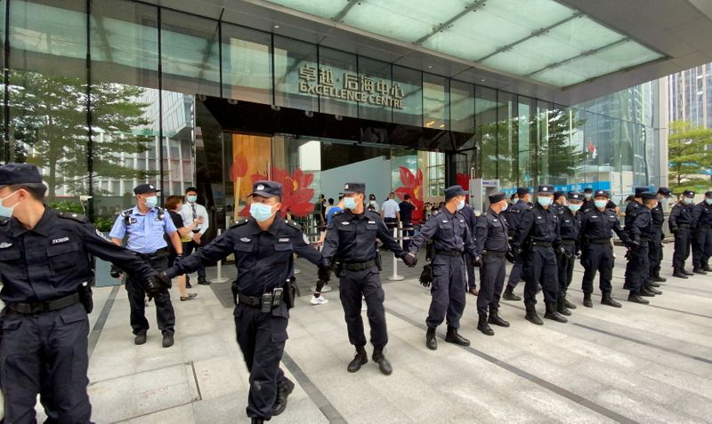 FILE PHOTO: People protest to demand repayment of loans and financial products at the Evergrande's headquarters, in Shenzhen