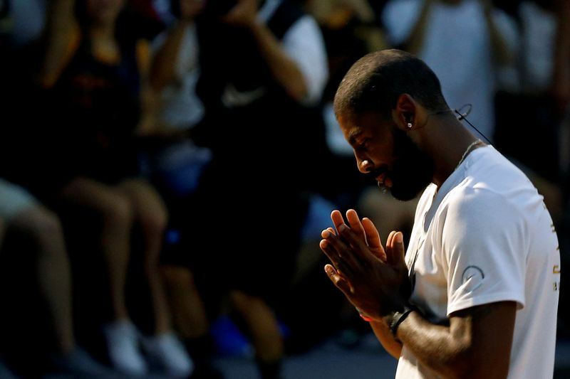 NBA player Kyrie Irving of the Cleveland Cavaliers reacts during a promotional event in Taipei