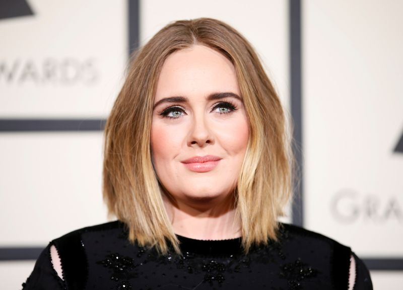 FILE PHOTO: Adele arrives at the 58th Grammy Awards in Los Angeles