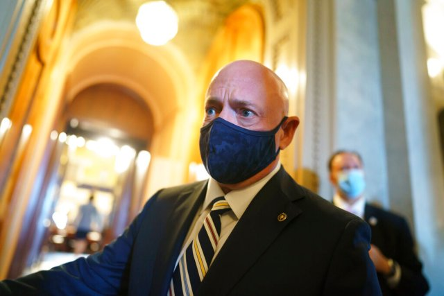 Sen. Mark Kelly, D-Ariz., arrives as lawmakers rush to the chamber for a confirmation vote, at the Capitol in Washington, Tuesday, Oct. 5, 2021. (AP Photo/J. Scott Applewhite)