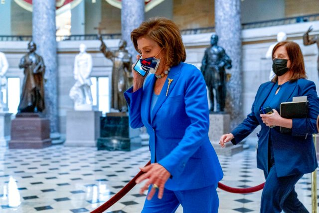 House Speaker Nancy Pelosi of Calif., walks towards the House Chamber to convene the House for legislative business at the Capitol in Washington, Tuesday, Oct. 12, 2021. The House is expected to vote to increase the debt limit later this afternoon. (AP Photo/Andrew Harnik)