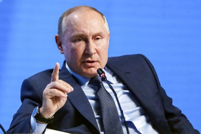 Russian President Vladimir Putin gestures while speaking at the plenary session of the Russian Energy Week in Moscow, Russia, Wednesday, Oct. 13, 2021. (Mikhail Metzel, Sputnik, Kremlin Pool Photo via AP)