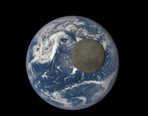 NASA Camera Shows Moon Crossing Face of Earth