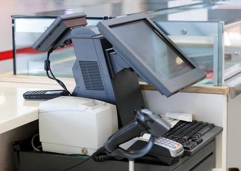 Cash desk with computer screen and Credit Card Machine with Barcode Scanner