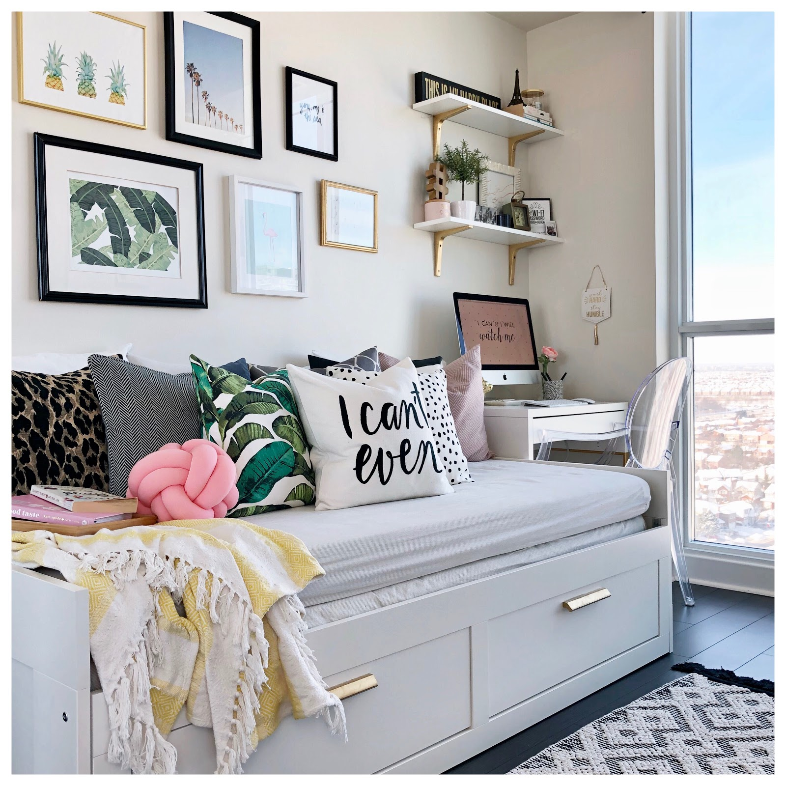 A day bed next to a small desk in a bedroom