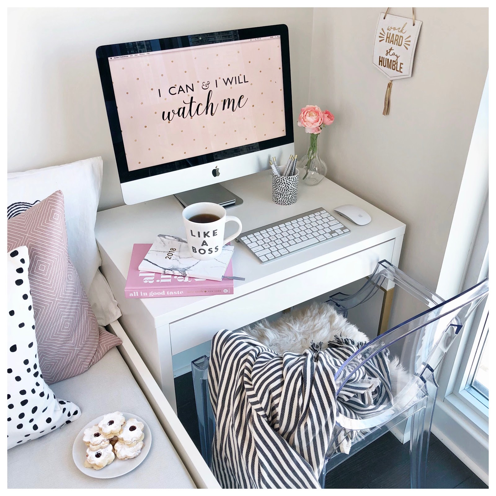 A desk, desktop computer, and a chair