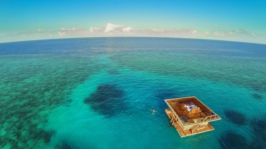 a hotel room submerged in water at The Manta Resort in Zanzibar