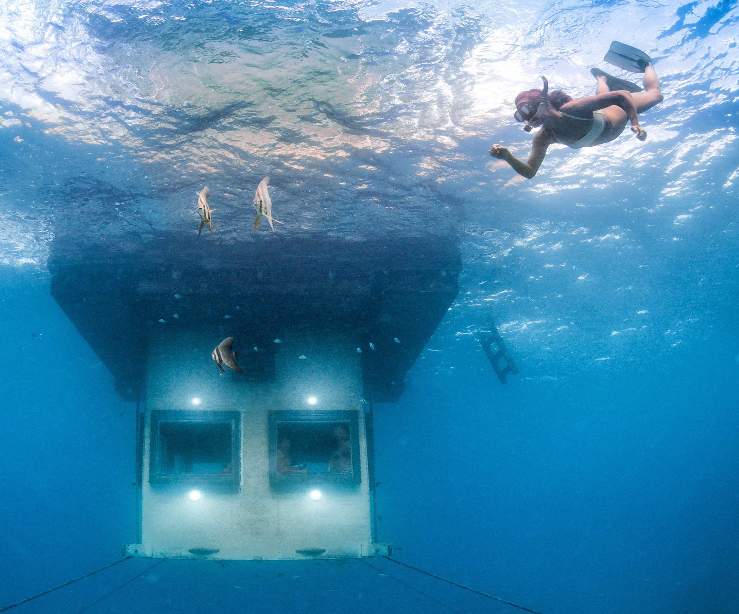a hotel room submerged in water at The Manta Resort in Zanzibar