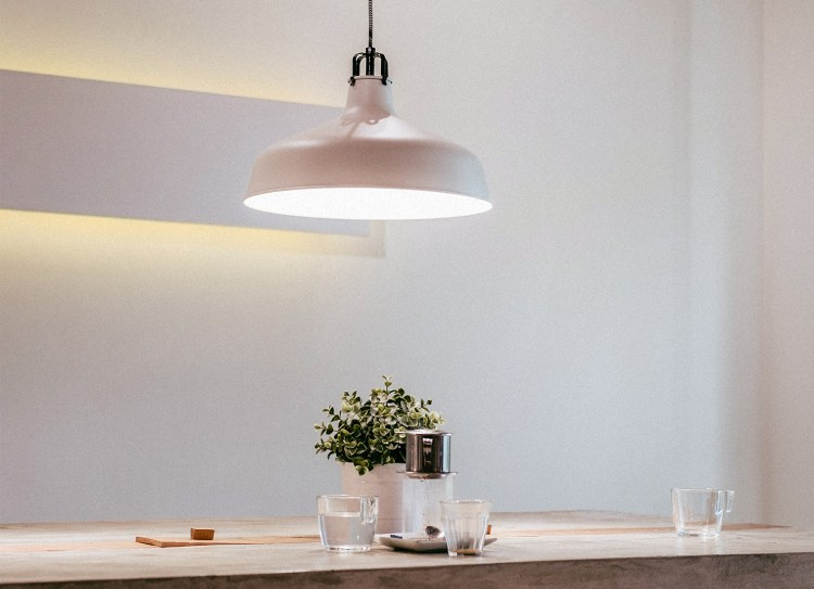 a pendant light over a dining table