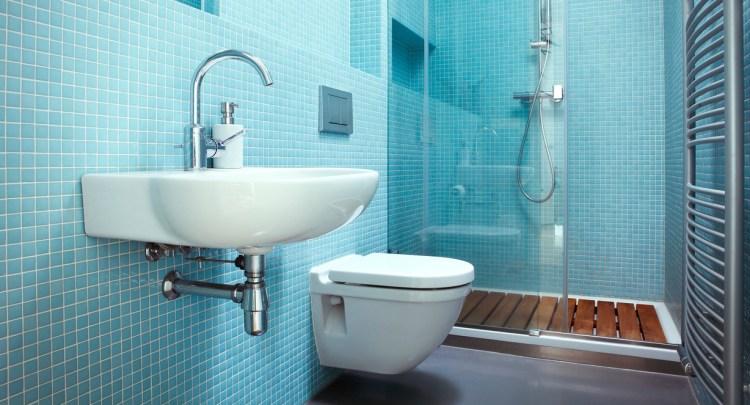 a bathroom with blue tiles on the wall
