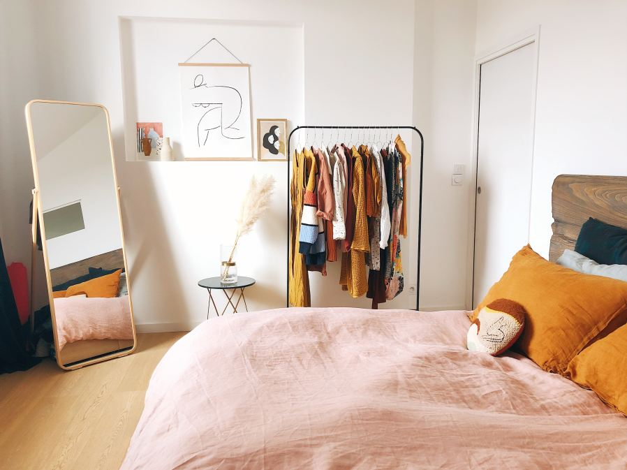 a bedroom decorated in mustard yellow and pale pink