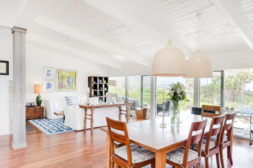 Dining and living room of an American Coastal home