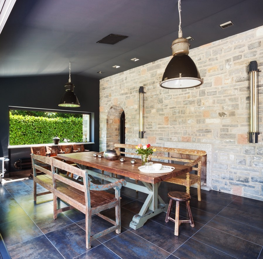 a stone feature wall in an outside dining space