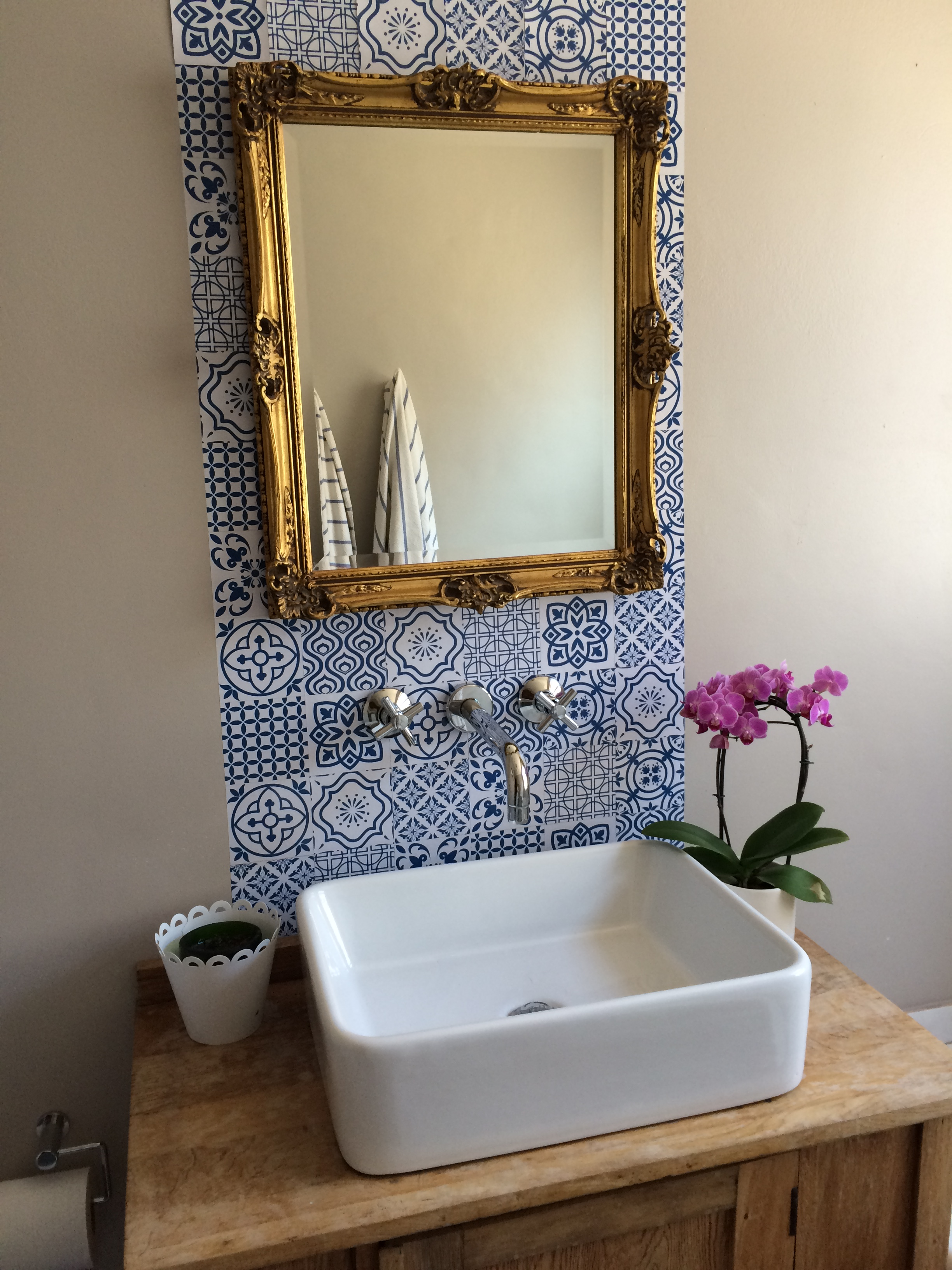a tiled backsplash in a bathroom