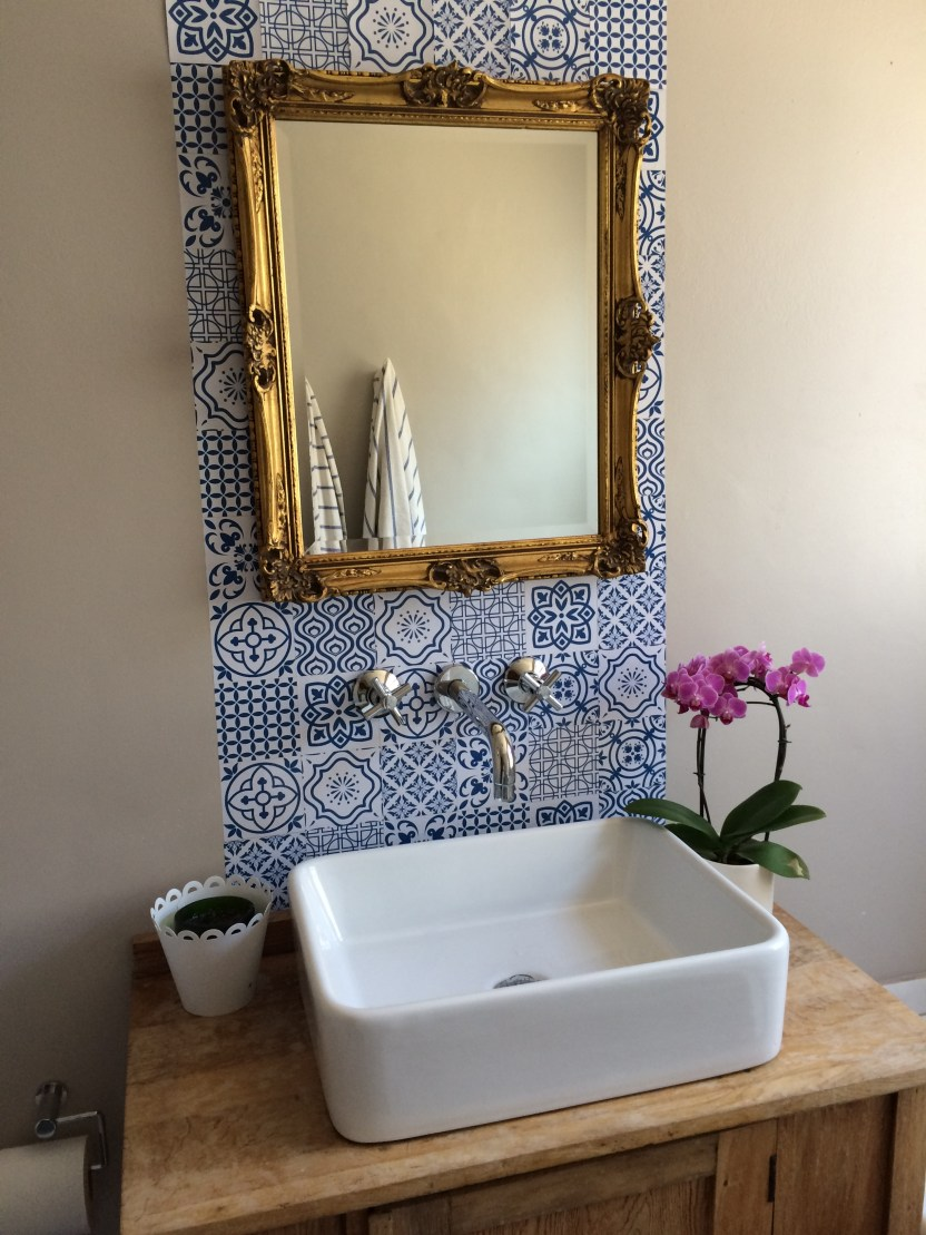 a tiled backsplash in a bathroom
