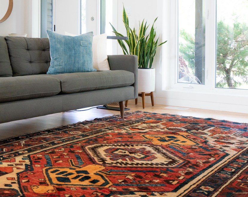 a rug on a living room floor