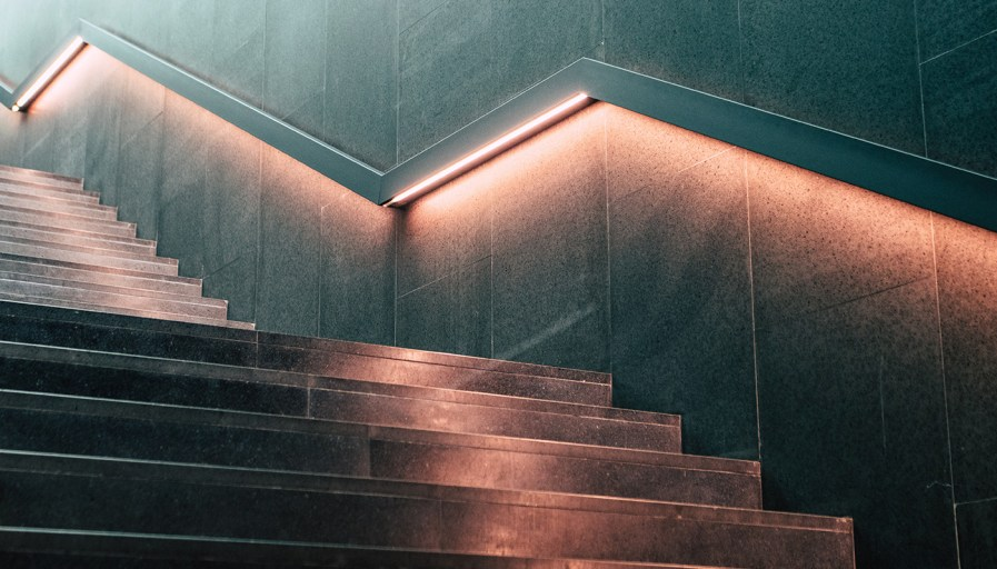 Staircase with rail under-lighting.