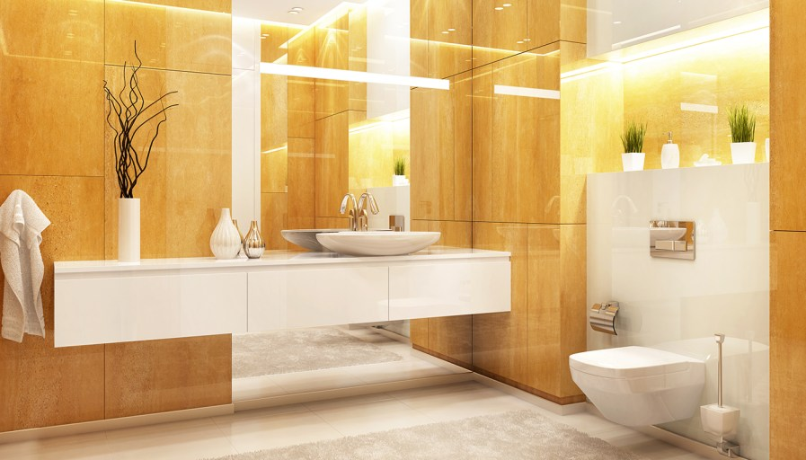 Bright, modern restaurant bathroom in white and gold