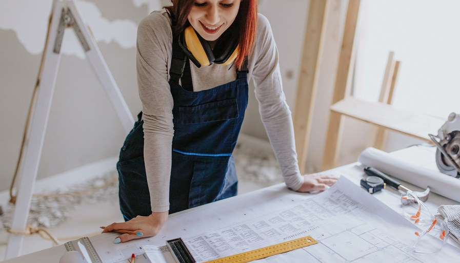 Woman looking over construction plans