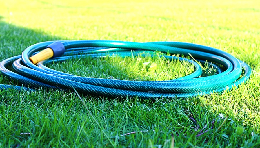 Garden hose neatly on the grass.