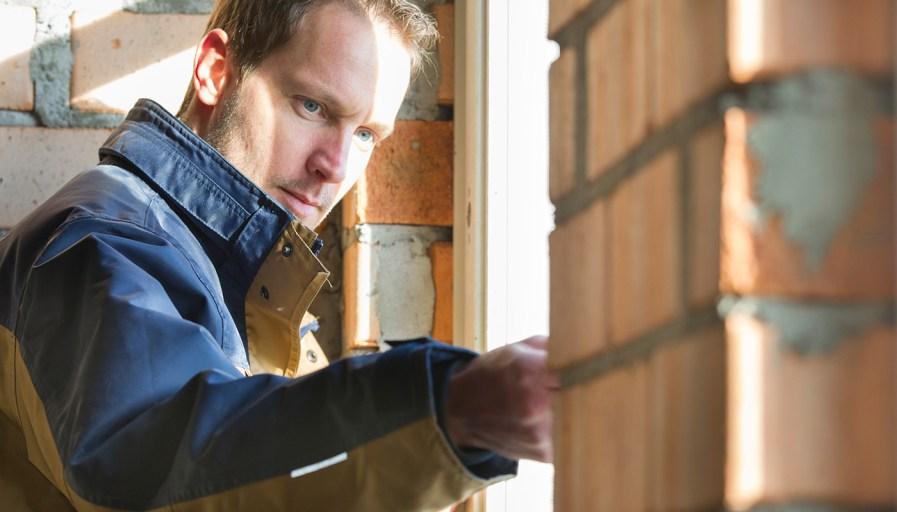 Man measuring width of a window