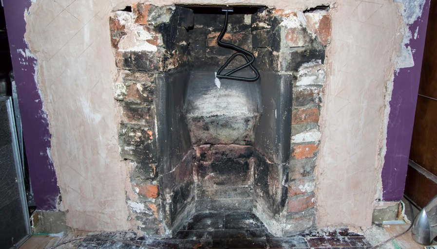 Fireplace that is under renovation to be refaced.