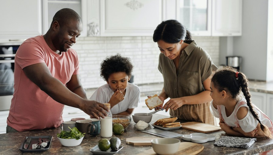 A family making food in their family home.