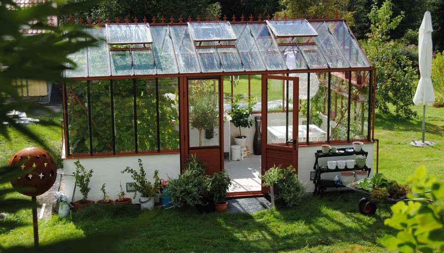 exterior shot of a greenhouse in a backyard