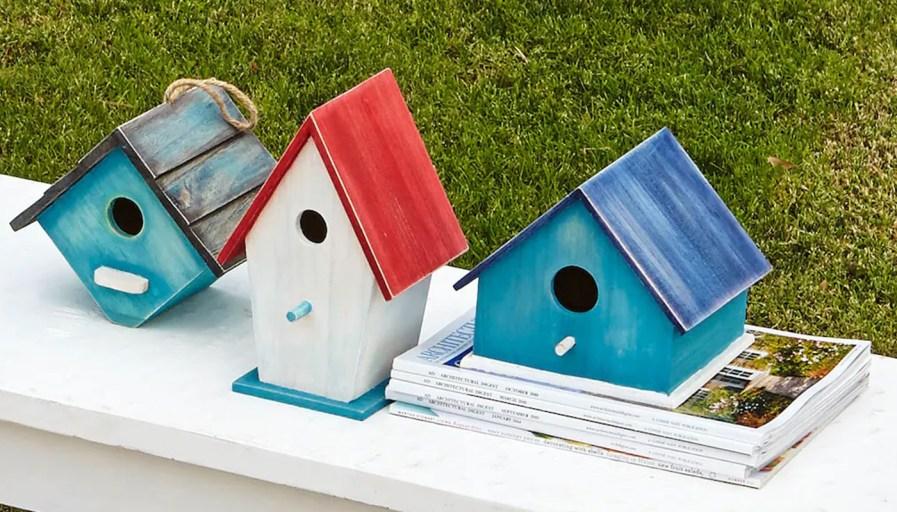 Row of colourful bird houses