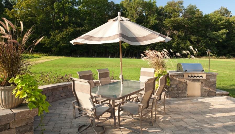 a set of patio furniture on an interlocking brick patio