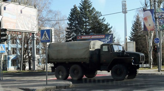 An unmarked military truck drives along a road in a territory controlled by the self-proclaimed Donetsk People's Republic in downtown Donetsk