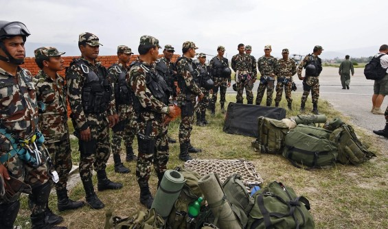 epa04749147 Nepal Army special force move form Kathmandu Airport to search for debris of a US helicopter after found in crash in Dolakha district, in Kathmandu, Nepal, 15 May 2015. According to reports, Nepal army has found the wreckage of a missing US military helicopter.  EPA/NARENDRA SHRESTA