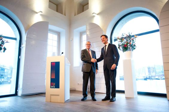 Dutch Prime Minister Mark Rutte, right, shakes hands with European Commission President Jean-Claude Juncker, as they pose  upon Junker's arrival at the Maritime Museum in Amsterdam, Netherlands, Thursday, Jan. 7, 2016. The Netherlands holds the EU presidency for the next six months. (AP Photo/Peter Dejong)