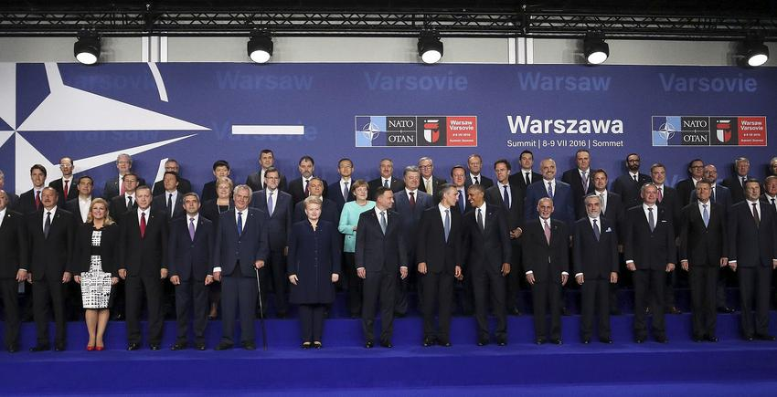 Participants in NATO Summit pose for a picture at PGE National Stadium in Warsaw