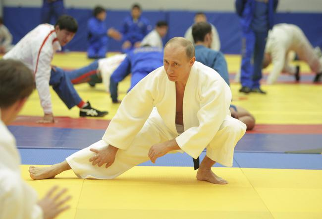 "Russia's Prime Minister Putin takes part in a judo training session at the ""Moscow"" sports complex in St. Petersburg"