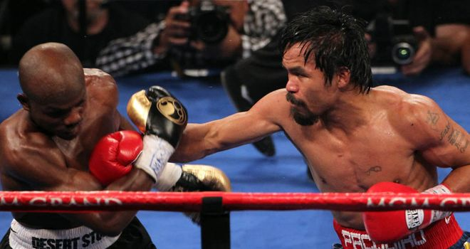 Pacquiao lands on Bradley in their first meeting