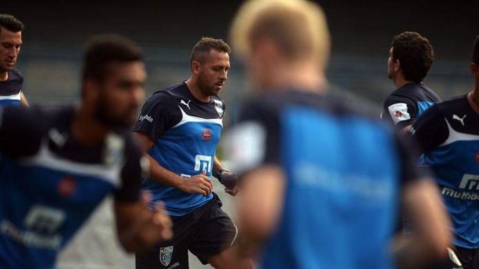 Kerala Blasters FC footballer Michael Chopra (C) trains with teammates on the eve of their Indian Super League (ISL) football match against Atletico De Kol