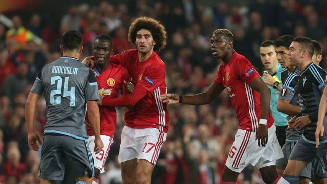 Eric Bailly is restrained by Marouane Fellaini