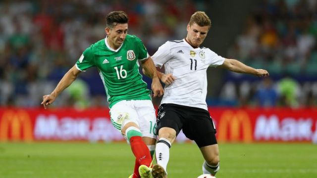 Hector Herrera and Timo Werner compete for the ball