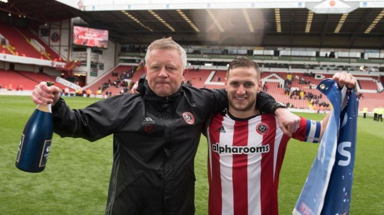 Wilder celebrates with Billy Sharp after Sheffield United won promotion back to the Championship in 2017