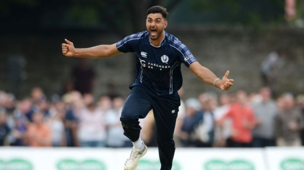 Scotland's Safyaan Sharif wheels away after sealing his side's momentous win
